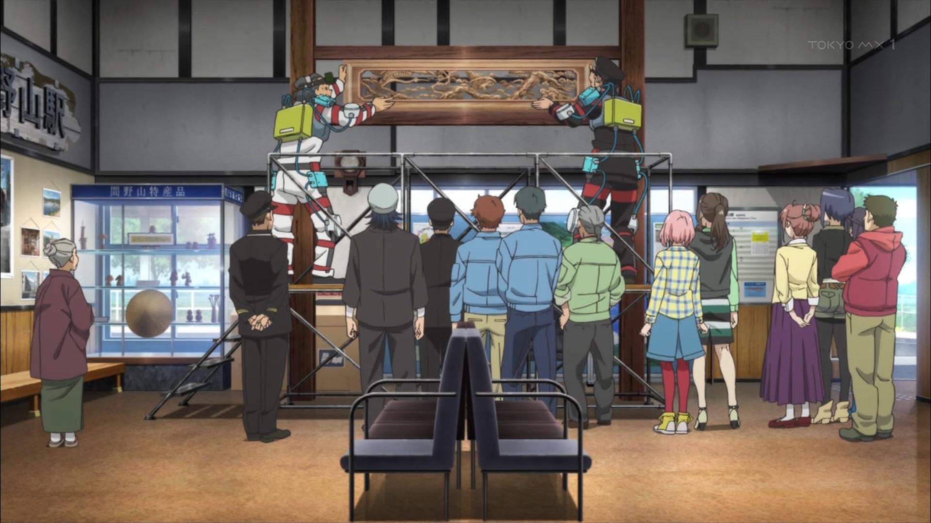 駅に飾る間野山彫刻(サクラクエスト5話画像)