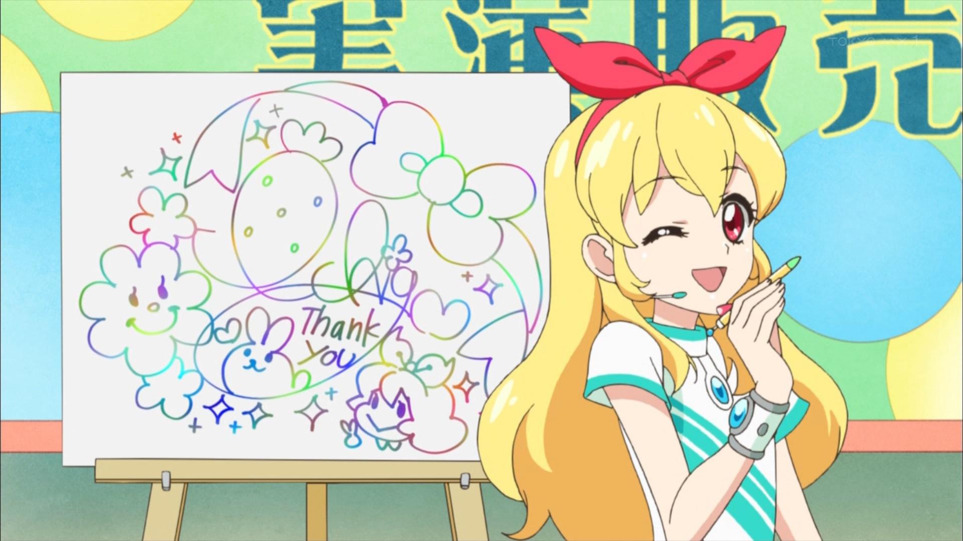 虹色サインペンでサインをする星宮いちご
